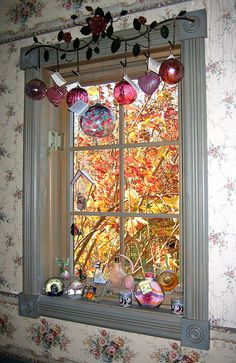 What a great way to display glass art near a window.