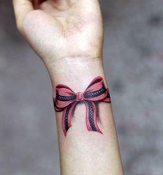Wrist bow tattoo, 50 Eye-Catching Wrist Tattoo Ideas | Cuded