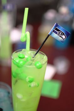 Here is ART Restaurant's Seahawks #12thMan cocktail made with tequila infused with green Skittles! Recipe: - 2oz Celestial Reposado infused with green Skittles - Cointreau - House Sour Mix - garnish with green Skittles and mini 12th Man Flag