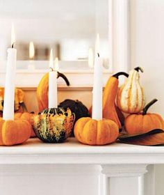 Turn mini pumpkins and gourds into candleholders.