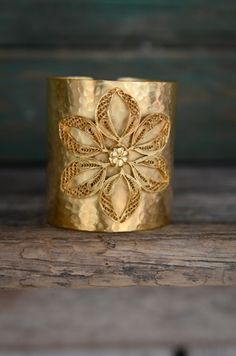 beautiful gold cuff made by tibetan refuges
