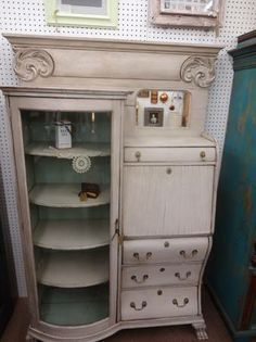 SOLD - Antique parlor cabinet - painted creamy white, antiqued and distressed 4 drawers - drop front cabinet-original glass door (cracked) on side curio.  ***** In Booth E8 at Main Street Antique Mall 7260 E Main St (east of Power RD on MAIN STREET) Mesa Az 85207 **** Open 7 days a week 10:00AM-5:30PM **** Call for more information 480 924 1122 **** We Accept cash, debit, VISA, MasterCard or Discover.