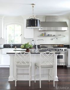 Peaceful Yet Practical: The designer replaced pleated fabric on the pendant shade with black metal for a sleeker look.