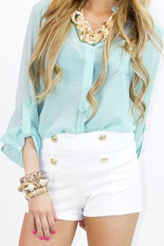 high waisted shorts. gold accents. pastel sheer shirt.