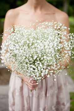 Baby's Breath Bridesmaid Bouquet, wouldn't go quite as big, but sweet and inexpensive