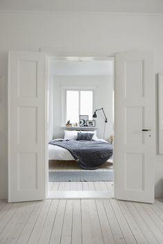 scandinavian white bedroom, grey throw