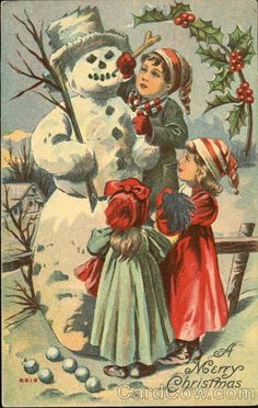 Three children making a snowman
