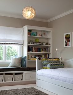 Love bookshelves on both side of a window and creating a window seat in between. by flora