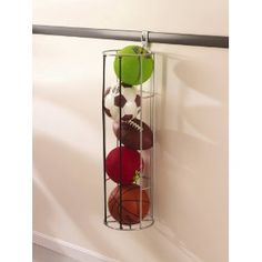 Sports ball rack to keep all of them in one place, instead of rolling all around your garage or house {featured on Household Management 101}