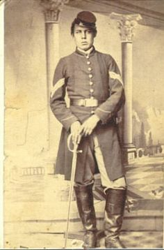 Portrait of John M. Royce 1862-1865. Hamburg. Enlisted in company E Twenty-sixth Infantry as Sergeant Aug. 4 1862 at Hamburg for 3 years age 18 ...Mustered out at Alexandria Va. June 4 1865. (Descriptive Roll Twenty-sixth Michigan Volunteers).