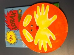 Dr. Suess' The Lorax craft. Let the kids paint a paper plate or circle. Then we can put their handprints on!