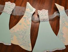 Wedding Dress Garland Paper Bridal Shower Decoration Sparkly White, Tiffany Green Blue, Silver, White, Lace, Floral. $22.00, via Etsy. - seller has tons more for ideas!