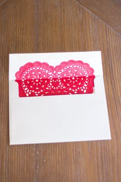 Heart doily lined envelope --> simple and sweet. love this, @Amy: Mod Podge Rocks