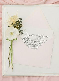 Elegant calligraphy wedding invitations, presented in blush pink envelopes. #wedding #invitation #spring
