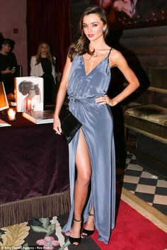 A whole lot of leg: Miranda Kerr looks perfect at the party in her flowing gown and Bvlgari accessories