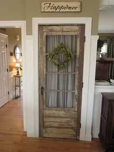 Old door on a kitchen pantry, love this!! But I dont know how practical. I mean, I dont know have salvaged door connections. And doors are notoriously hard to hang, even pre-hung ones. So how would an old and off sized door manage to fit? But theoretically, I love this, and many other things on the blog post this links.