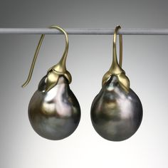 """Gabriella Kiss...A pair of 18k gold """"Eggplant"""" earrings with dark Tahitian pearls. Total length is 1.25""""."""