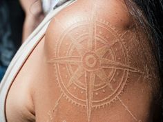 White ink tattoo. Compass