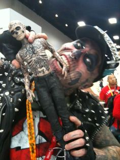Zombie on Zombie violence, SDCC fun: Zombie Boy Rick Genest Biting Zombie Boy - SDCC