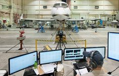 NASA Dryden Flight Loads engineer William Lokos monitors a wing loading test of NASA G-III 804 during recent testing in support of the Adaptive Compliant Trailing Edge, or ACTE, project.