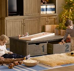 Awesome kids activity table and toy box underneath - and this website is very cool!