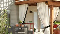 All-weather drapery adds a soft, unexpected touch, as well as privacy, to this outdoor space.