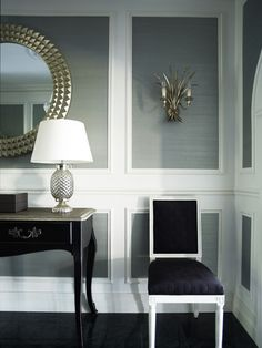 Extra wide moldings that frame warm gray grasscloth