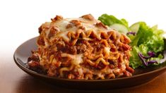 Home-cooked lasagna on a weeknight?  Yes!  Thanks to the slow cooker and no precooking of the noodles!