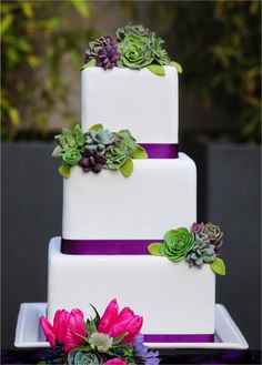 Change out Purple ribbon & put an H on middle or bottom layer! White wedding cake with pink, purple and green details. Love succulents. Plus teal.