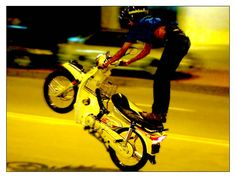 Another mat rempit performing another crazy stunt