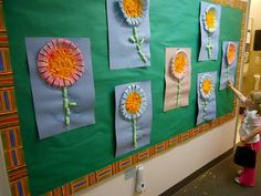 Preschool flower art made with paper bowls from @Sheryl Cooper (Teaching 2 and 3 Year Olds)