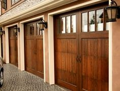 Barn style garage door for craftsman homes. These gorgeous doors are perfect for any home looking for a rustic feeling. #doors #rustic #barndoors