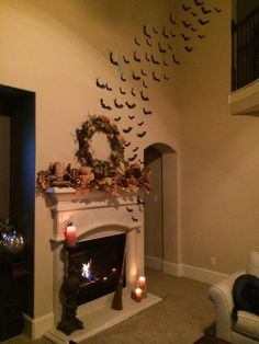 """My living room! Decorating for fall early!  Halloween Bats flying out of fireplace found on Etsy from """"Jenn and Rome""""-perfect!  www.morethananimage.com"""