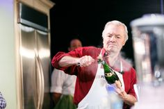 """Jacques Pépin sabered a bottle of champagne during his """"Techniques to Create a Great Meal"""" demo. Photo by Allan Zepeda."""