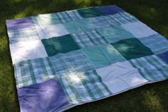 Beach/picnic blanket - squares of old towels and back with a tablecloth to repel moisture/sand