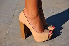 Nude stacked heels.