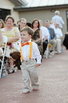 Ring bearer with wedding color suspenders and bow tie. So much cuter than kids in rented tuxes!
