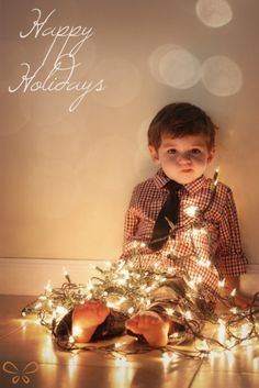 Wrapping your children in Christmas lights makes for a great picture to put on holiday cards.  #Christmas #holidays #children #photography #cards