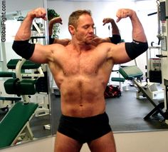 a goatee muscleman flexing gym