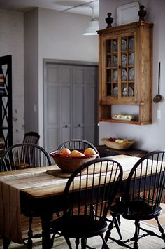country kitchen. black Windsor chairs.