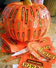 DIY Project Ideas: Halloween Candy Wrapper Crafts... how cute! My hubby would love eating all those so I could make this! Lol