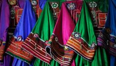Traditional Afghan clothes for women are seen for sale at a shop in Kabul, capital of Afghanistan.Photo by Ahmad Massoud.