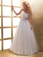 Feathers and tulle - talk about a fairytale dress! I'm in love. Maggie Sottero #Wedding Dresses - Style Misha 12433 - http://thealternativebride.com