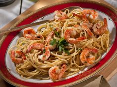 Shrimp Scampi with Linguini from FoodNetwork.com recipe from Tyler Florence.  My Shrimp & Linguini is made with plum tomatoes (or sun dried tomatoes) and mushrooms.  I use extra garlic, white wine and lemon juice.  Skin tomatoes by placing in boiling water (make small slits on top and bottom of tomatoes for approx. 30-45 seconds and plunge into cold water and peel and remove seeds) and chop tomatoes.  Saute mushrooms and tomatoes in butter and garlic, add wine, then add shrimp till pink