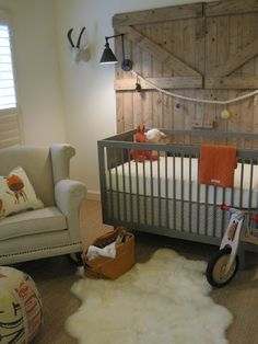 love this barn door-inspired wall..colors and syle of this nursery