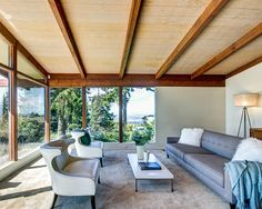 mid century modern living room with a view