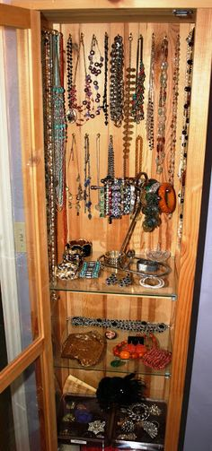 Practical home solution; simple cabinet (Ikea) and a few hooks, make for a perfect jewelry solution ~ see it all and nothing gets tangled.