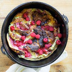 Campfire Raspberry Double Dutch Baby | MyRecipes.com. Don't see why you can't do this on the stove top.