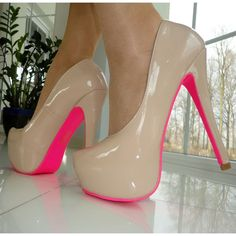 Nude heels with neon pink bottoms