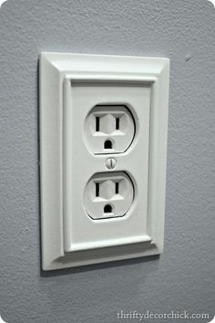 Decorative outlet cover with moulding - buy these at Lowes.